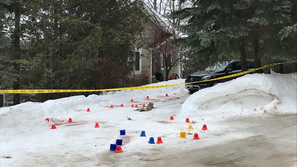 The OPP has lined a property in Clearview Township with police tape and evidence markers as they investigate a shooting on Mar. 2, 2020. (CTV News)
