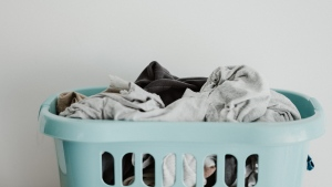 A pile of laundry is seen in this stock image. (Photo by Annie Spratt on Unsplash)