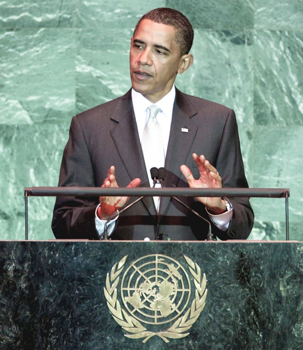U.S. President Barack Obama approaches the podium to address the Summit on Climate Change at the United Nations, Tuesday, Sept. 22, 2009. (AP / Richard Drew)