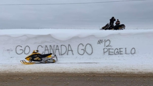 A 12-foot snowbank near Cargill, Ont. turned into a giant billboard is seen on Tuesday, March 3, 2020. (Scott Miller / CTV London)