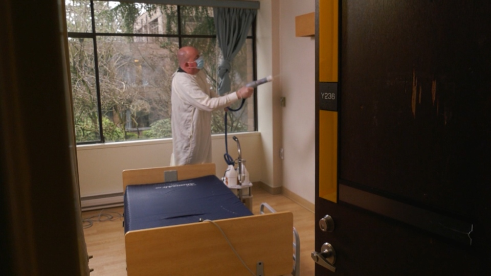 Fraser MacDougall, an employee with the New Vista Society, cleans a room at a B.C. care home on March 3, 2020.