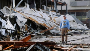 A man looks over buildings destroyed by storms Tuesday, March 3, 2020, in Nashville, Tenn. (AP / Mark Humphrey)
