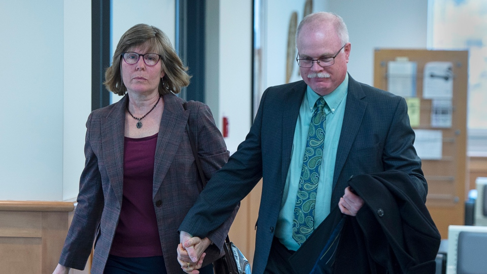 John Collyer, former Bridgewater police chief, heads into Nova Scotia Supreme Court with his wife Sheri Collyer in Bridgewater, N.S. on Wednesday, March 4, 2020 for his sentencing. (THE CANADIAN PRESS/Andrew Vaughan)