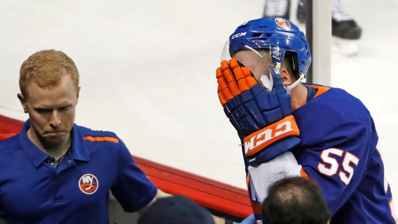 In this Tuesday, March 3, 2020 file photo, New York Islanders defenseman Johnny Boychuk (55) leaves the ice with a trainer after he was clipped in the face near his eye by the skate of Montreal Canadiens left wing Artturi Lehkonen during the third period of an NHL hockey game in New York. (AP Photo/Kathy Willens)