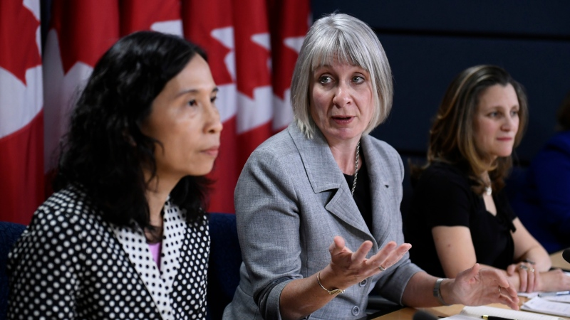 Minister of Health Patty Hajdu looks towards Chief Public Health Officer of Canada Dr. Theresa Tam, as Deputy Prime Minister Chrystia Freeland listens during an update on coronavirus disease (COVID-19) at the National Press Theatre in Ottawa, on Wednesday, March 4, 2020. THE CANADIAN PRESS/Justin Tang