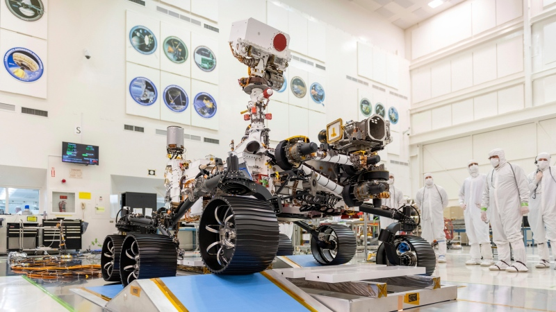 In this Dec. 17, 2019 photo made available by NASA, engineers watch the first driving test for the Mars 2020 rover in a clean room at the Jet Propulsion Laboratory in Pasadena, Calif. (J. Krohn/NASA via AP)