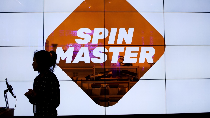 A person is silhouetted at the Spin Master toy and entertainment company in Toronto on Tuesday, January 29, 2019. THE CANADIAN PRESS/Nathan Denette
