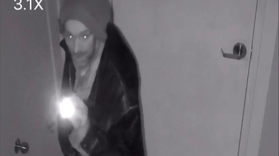 Security cameras show a man breaking in to a business on Jasper Avenue.
