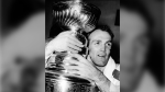 Montreal Canadiens forward Henri (Pocket Rocket) Richard hugs the Stanley Cup awarded to the National Hockey League champions in Detroit, Mich., Thursday night, May 5, 1966. THE CANADIAN PRESS/AP