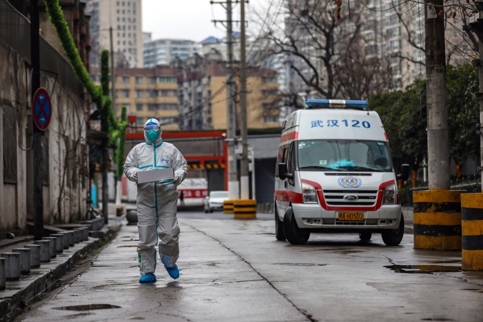 Ambulance worker carrying supplies in Wuhan, China