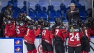 Canada head coach Perry Pearn speaks to his players as they take on Sweden during first period of 2018 Four Nations Cup preliminary game in Saskatoon, Tuesday, November 6, 2018. THE CANADIAN PRESS/Liam Richards