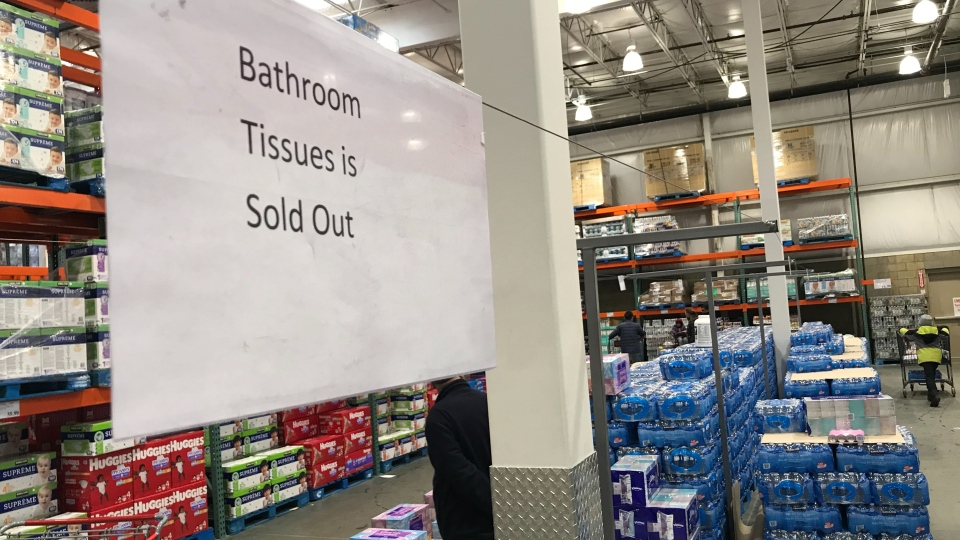 A sign at an Edmonton Costco alerts shoppers that bathroom tissue has been sold out on March 7, 2020.