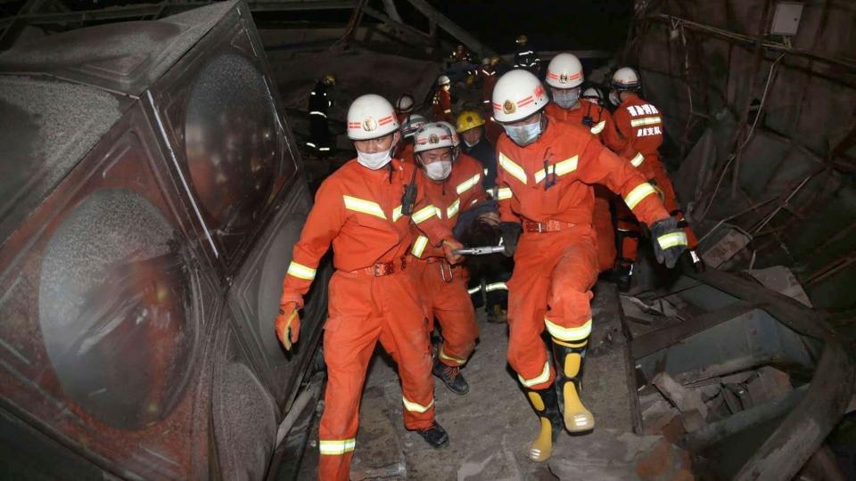 Rescuers evacuate injured person