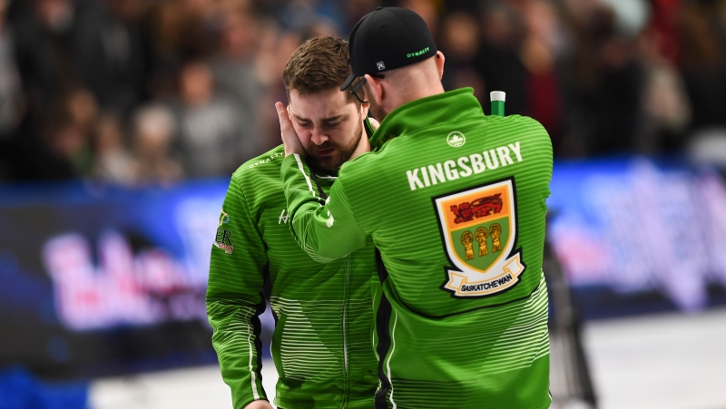 Team Saskatchewan skip Matt Dunstone, gets a hug from coach Adam Kingsbury as he reacts to a 7-6 loss to Team Newfoundland skip Brad Gushue in the Brier semifinal in Kingston, Ont., on Sunday, March 8, 2020. THE CANADIAN PRESS/Sean Kilpatrick