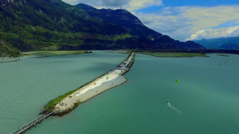 The Squamish Spit is a man-made berm originally built in the early 1970s as a coal port that never developed. Over the years, it became a well-known launch site for kite surfing, attracting thousands of people annually.