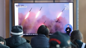 In this file photo, people watch a TV showing file images of North Korea's missile launch during a news program at the Seoul Railway Station in Seoul, South Korea, Monday, March 9, 2020. (AP Photo/Ahn Young-joon)