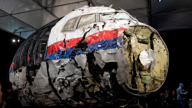 In this Oct. 13, 2015 file photo, shows the reconstructed wreckage of Malaysia Airlines Flight MH17, put on display during a press conference in Gilze-Rijen, central Netherlands. United by grief across oceans and continents, families who lost loved ones when Malaysia Airlines Flight 17 was shot down in 2014 hope that a trial starting next week will finally deliver them something that has remained elusive ever since: The truth. (AP Photo/Peter Dejong, File)