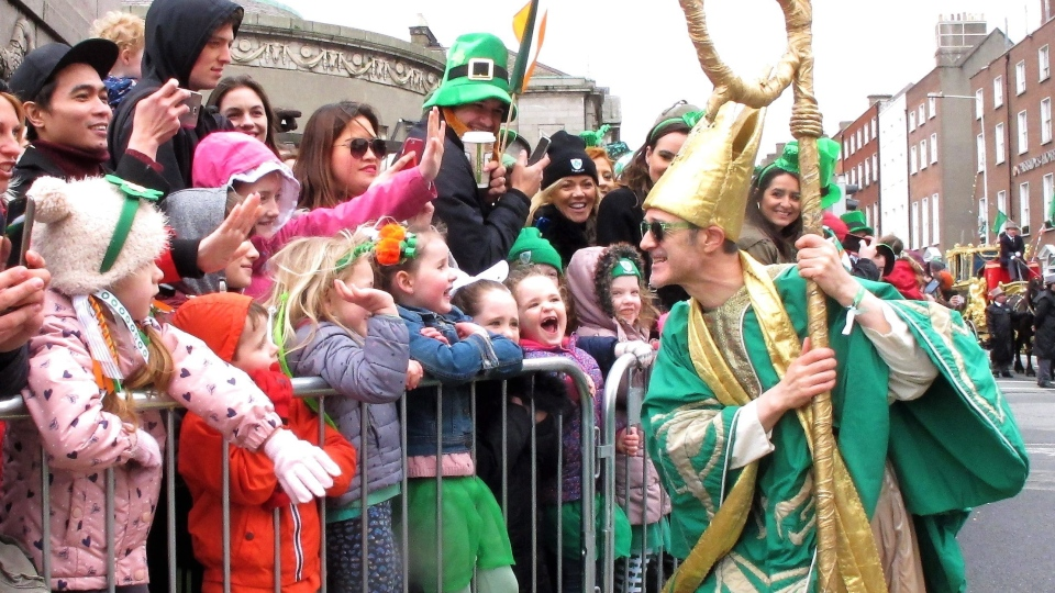 Saint Patrick as portrayed by Irish actor Johnny Murphy clowns around with children watching the St. Patrick's Day parade in Dublin, Ireland, Friday, March 17, 2017.  (AP Photo/Shawn Pogatchnik)