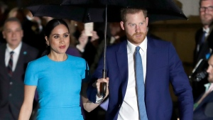 Prince Harry and Meghan, the Duke and Duchess of Sussex, arrive at the annual Endeavour Fund Awards in London, Thursday, March 5, 2020. (AP Photo/Kirsty Wigglesworth)