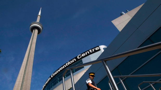 An RCMP officer patrols outside the Metro Toronto Convention Centre in this Friday June 25, 2010 file photo. (THE CANADIAN PRESS/Frank Gunn)