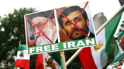 Demonstrators rally against Iranian President Mahmoud Ahmadinejad across the street from UN headquarters in New York on Sept. 23, 2009. (AP / Jason DeCrow)