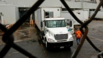 A driver pulls into the truck delivery bay at the General Motors plant in Oshawa, Ont., Tuesday, September 25, 2007. THE CANADIAN PRESS/J.P. Moczulski