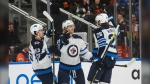 Winnipeg Jets' Mark Scheifele (55), Kyle Connor (81)and Blake Wheeler (26) celebrate a goal against the Edmonton Oilers during third period NHL action in Edmonton, Alta., on Wednesday March 11, 2020. (Source: The Canadian Press/Jason Franson)