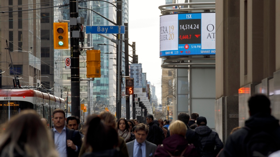 The TSX is shown on a business news ticker is seen in the Financial District in Toronto, Monday, March 9, 2020. THE CANADIAN PRESS/Cole Burston