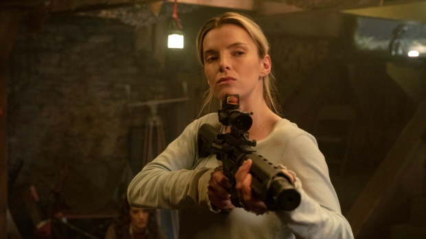 This image released by Universal Pictures shows Betty Gilpin in a scene from 'The Hunt.' (Patti Perret/Universal Pictures via AP)
