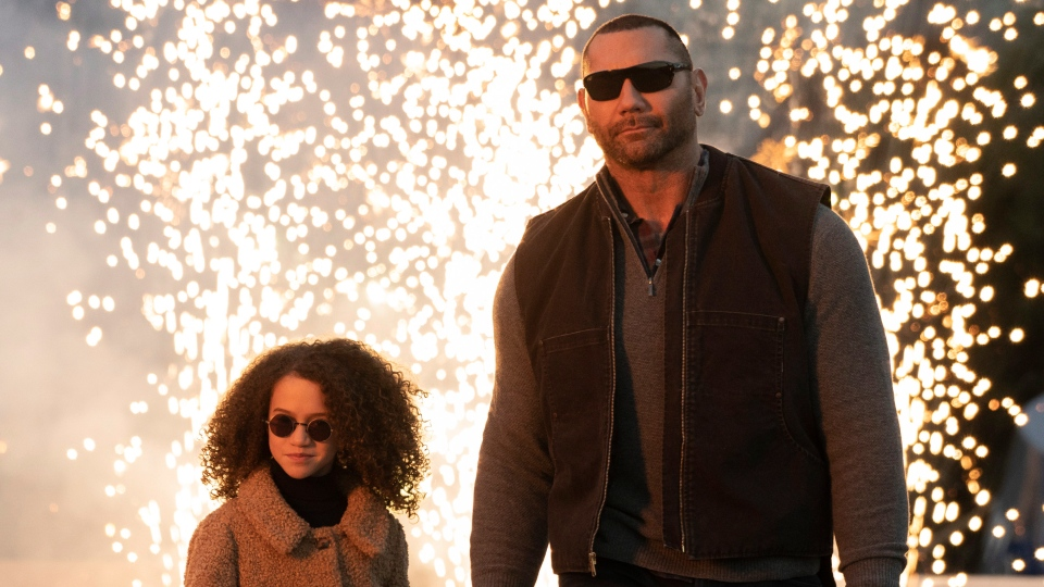 This image released by STXfilms shows Chloe Coleman, left, and Dave Bautista in a scene from 'My Spy.' (Michael Gibson/STXfilms via AP)