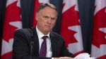 David McGuinty, chair of the National Security and Intelligence Committee of Parlmentarians holds a new conference to release committee's annual report, in Ottawa, Thursday, March 12, 202. THE CANADIAN PRESS/Fred Chartrand