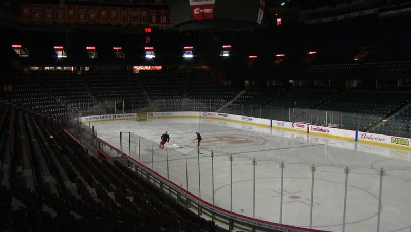 Two members of the Calgary Flames on the ice of the Scotiabank Saddledome on March 12 prior to the announcement of the suspension of the 2019-2020 NHL season