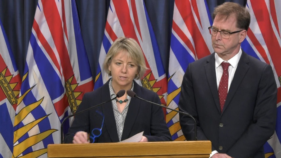 B.C. provincial health officer Dr. Bonnie Henry, left, and Health Minister Adrian Dix announce seven new cases of COVID-19 from Victoria on March 12, 2020.