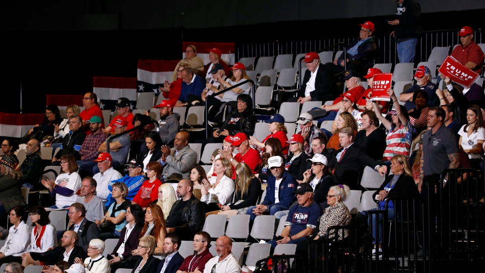 In this Feb. 21, 2020, photo, attendees listen as President Donald Trump speaks during a campaign rally in Las Vegas. The Trump show has a consistent script, with villains, nicknames, grievances and the same hero: himself. (AP Photo/Patrick Semansky)