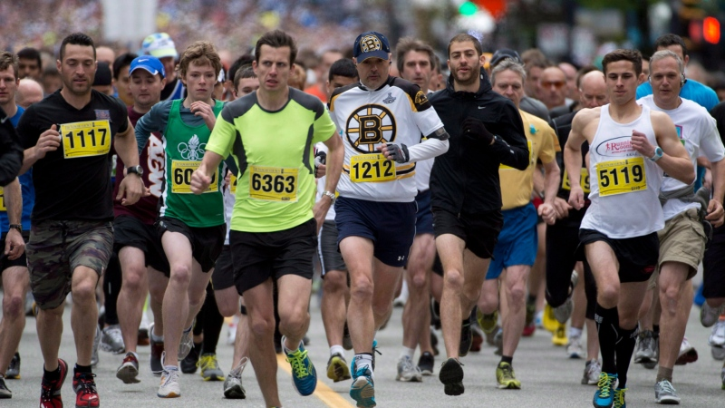 A runner is seen wearing a Boston Bruins jersey at the start of the Vancouver Sun Run in downtown Vancouver, B.C. Sunday, April 21, 2013. THE CANADIAN PRESS/Jonathan Hayward
