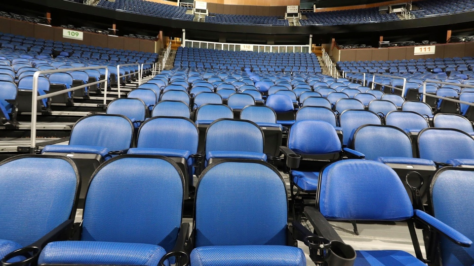 The seats are empty at the Amway Center in Orlando, home of the NBA's Orlando Magic, on Thursday, March 12, 2020.(Stephen M. Dowell /Orlando Sentinel via AP)