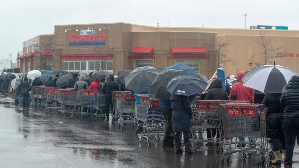 People line up for supplies outside the Costco sto