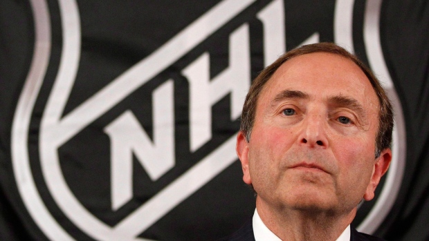 In this Sept. 13, 2012, file photo, NHL commissioner Gary Bettman listens as he meets with reporters after a meeting with team owners in New York. THE CANADIAN PRESS/AP/Mary Altaffer