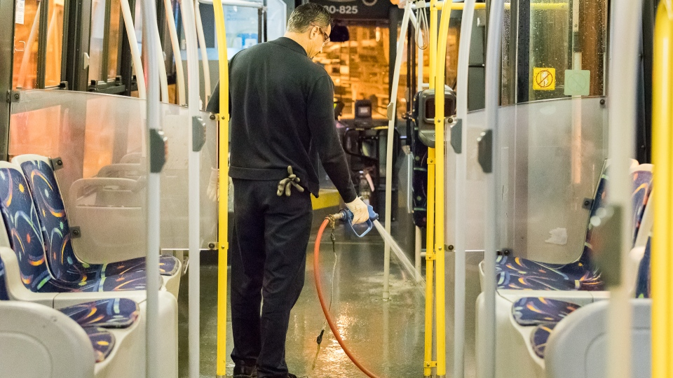 STM staff cleaning a bus
