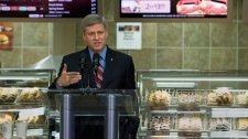 Prime Minister Stephen Harper speaks at a Tim Horton's test facility in Oakville, Ont., on Wednesday Sept. 23, 2009. (Frank Gunn / THE CANADIAN PRESS)