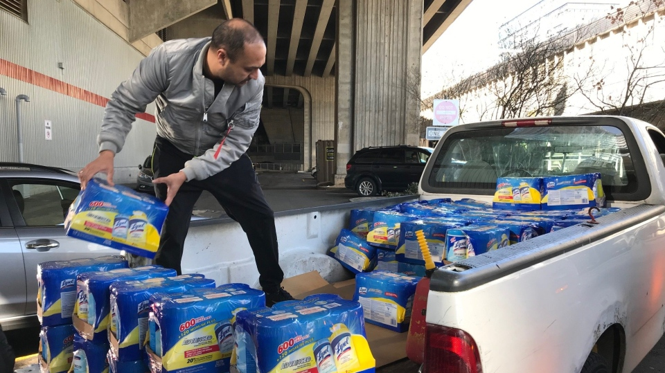 Manny Ranga loads his truck with Lysol wipes that he bought in bulk Wednesday at a Costco store near downtown Vancouver. Ranga and his wife buy the supplies in bulk ad resell them on Amazon. (Douglas Quan/Toronto Star)