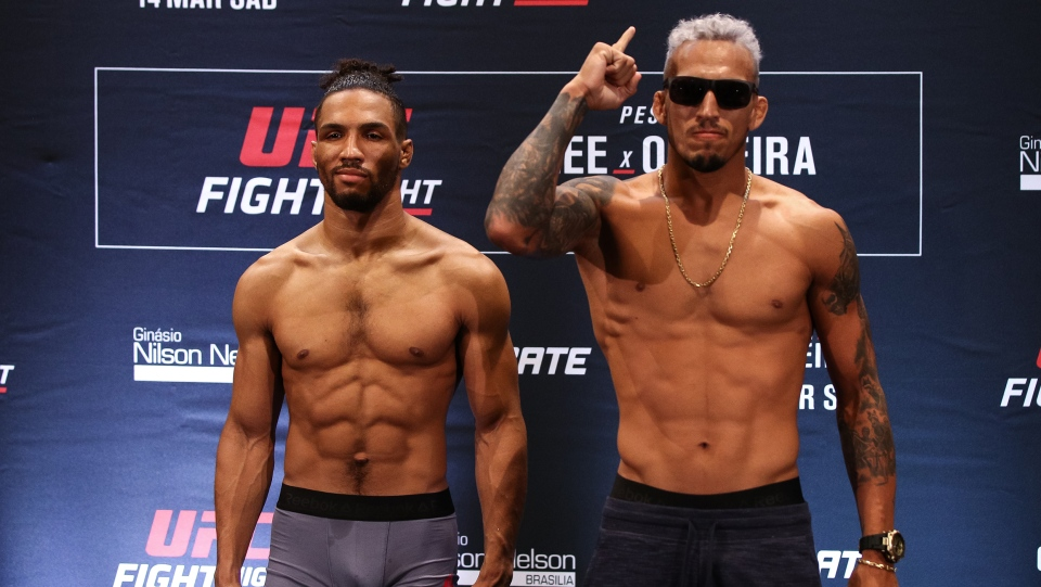 Opponents Kevin Lee of the United States and Charles Oliveira of Brazil face off during  the UFC Fight Night weigh-in at Windsor Plaza Hotel on March 13, 2020, in Brasilia, Brazil. (Buda Mendes/Zuffa LLC/Getty Images)