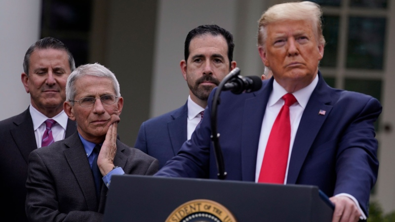 Dr. Anthony Fauci, director of the National Institute of Allergy and Infectious Diseases, second from left, and President Donald Trump, right, listen during a news conference about the coronavirus in the Rose Garden of the White House, Friday, March 13, 2020, in Washington. (AP / Evan Vucci)