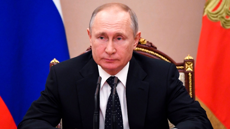 Russian President Vladimir Putin chairs a Security Council meeting in Moscow, Russia, Friday, March 13, 2020. Agreements with Turkey on the situation in Idlib, stock markets and the coronavirus epidemic were discussed at the meeting, according to Kremlin spokesman Dmitry Peskov. (Alexei Nikolsky, Sputnik, Kremlin Pool Photo via AP)
