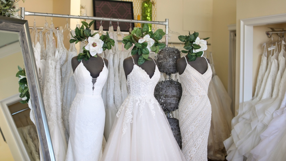 Wedding dresses are displayed at Complete Bridal, a shop in East Dundee, Illinois, on February 28, 2020. The store is heavily reliant on China for manufacturing. Factory closures there have meant fewer choices for brides. Those with weddings coming up soon have to buy off the rack and forego customization. (AP Photo/Teresa Crawford)