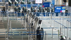 Check in areas are pictured at Vancouver International Airport in Richmond, B.C. Friday, March 13, 2020. THE CANADIAN PRESS/Jonathan Hayward