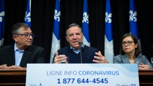 Quebec Premier Francois Legault, centre, announces measures against Covid-19 virus, Saturday, March 14, 2020 at the legislature in Quebec City alongside Quebec national public health director Horacio Arruda, left, and Quebec Health Minister Danielle McCann. THE CANADIAN PRESS/Jacques Boissinot