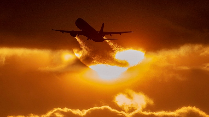 An aircraft takes off from the airport in Frankfurt, Germany, Friday, March 13, 2020. (AP Photo/Michael Probst)