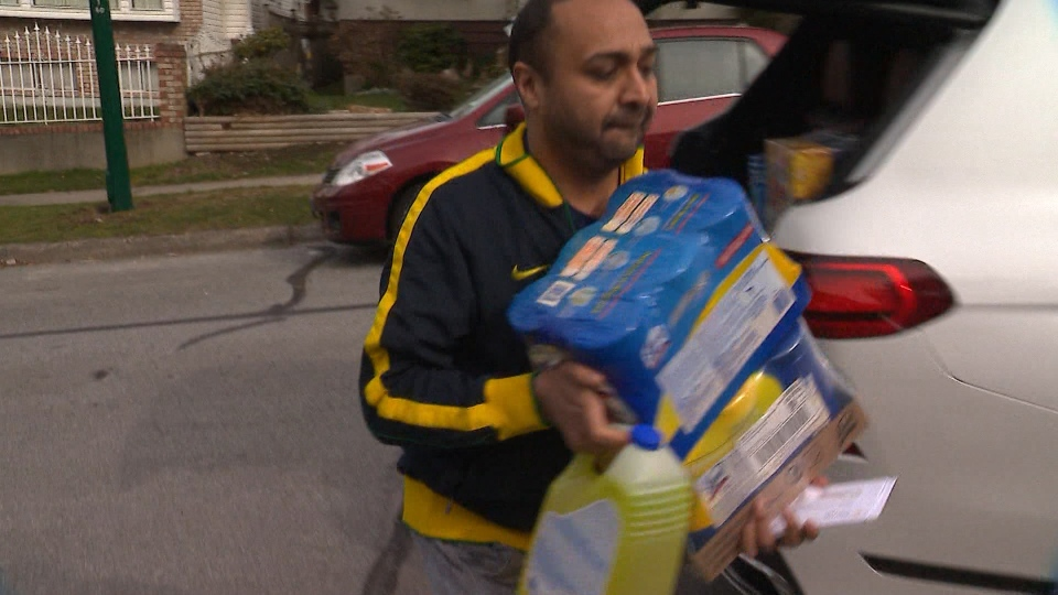 Vancouver resident Manny Ranga unloads cleaning supplies from his car on Friday, March 13, 2020. (CTV)