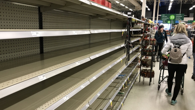 Near empty shelves are pictured at a grocery store in North Vancouver, B.C. Saturday, March 14, 2020. THE CANADIAN PRESS/Jonathan Hayward